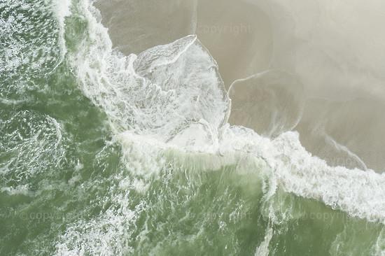Wave break along the beach