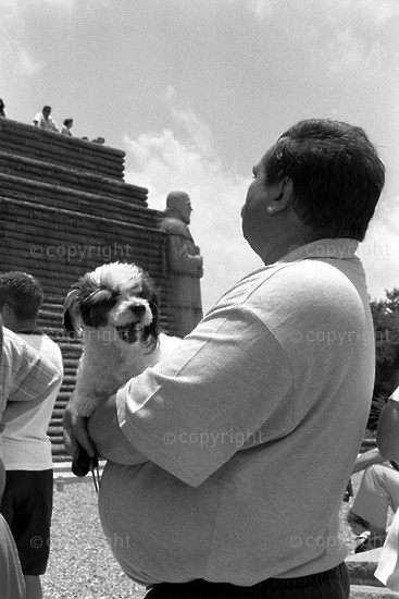 2001 A man and his dog wait their turn to enter the monument