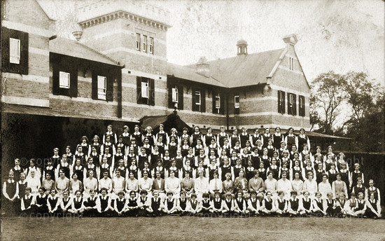 Post card: St Anne's community in front of school buildings